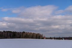 Winter landscape in Central Russia. Russian landscapes are diverse at any time of the year. In winter, the combination of forest, meadows and fields covered stock photography