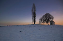 Winter landscape with chapel Royalty Free Stock Photos
