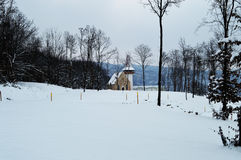 Winter Landscape with a chapel in back Stock Photos