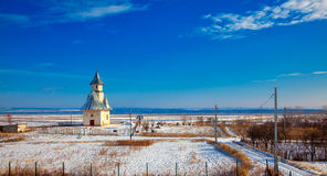 Winter landscape with church royalty free stock photography
