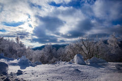Winter landscape and cloudy sky Stock Images