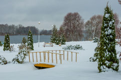 Winter landscape. cloudy weather. a park zone on the coast of the lake Royalty Free Stock Photo
