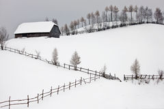 Winter landscape with cottage above the hill Royalty Free Stock Images
