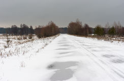 Winter landscape with country road in Ukraine Stock Photos