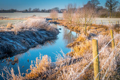 Winter landscape in the countryside. A frosty winter`s morning in the English countryside with the sun rising off the fields Royalty Free Stock Photos