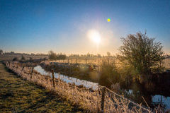 Winter landscape in the countryside. A frosty winter`s morning in the English countryside with the sun rising off the fields Royalty Free Stock Photo