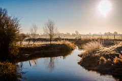 Winter landscape in the countryside. A frosty winter`s morning in the English countryside with the sun rising off the fields Royalty Free Stock Images