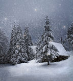 Winter landscape. Cozy house in the snow Royalty Free Stock Image