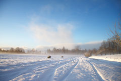 Winter landscape with dark clouds coming over sky Royalty Free Stock Image