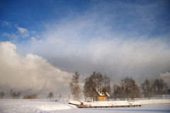 Winter landscape with dark clouds coming over sky Stock Photo