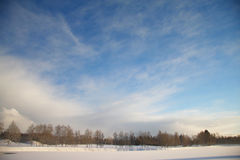 Winter landscape with dark clouds coming over sky Stock Image