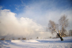 Winter landscape with dark clouds coming over sky Stock Photography