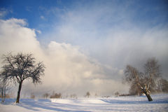 Winter landscape with dark clouds coming over sky Royalty Free Stock Photography