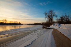 Winter landscape, dawn over the river Royalty Free Stock Image