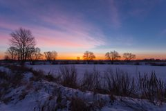 Winter landscape, dawn over the river Royalty Free Stock Images
