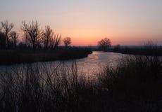 Winter landscape, dawn over the river Stock Photos