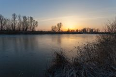 Winter landscape, dawn over the river Royalty Free Stock Photography