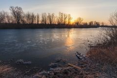 Winter landscape, dawn over the river Stock Photos