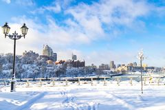 Winter landscape of the Dnepr city , covered with snow and hoarfrost. View of the buildings  skyscrapers  and park  from the Monastery Island. Ukraine Stock Image