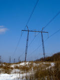 The Winter landscape with electric power line Stock Photo