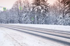 Winter landscape, empty asphalt road stock photos