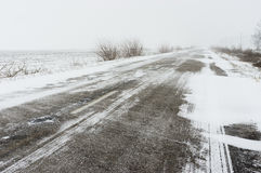 Winter landscape with empty highway and snow-drift Stock Image