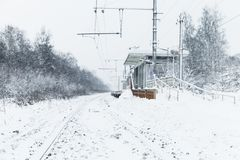 Winter landscape with empty railway. Winter landscape with an empty rural railway and station building stock image