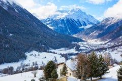 Winter landscape of the Engadine valley in a sunny morning, Guarda, Lower Engadine, Graubunden, Switzerland.  stock photo