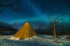 Winter Landscape with Eskimo Tent and Northern Lights. Winter Landscape with Eskimo Tent and Northern Lights in the National Park stock photo