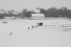 Winter landscape in the fields with people enjoying the snow Stock Photos