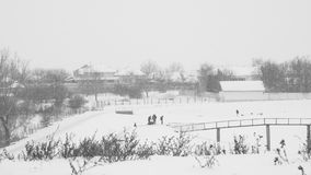 Winter landscape in the fields with people enjoying the snow Stock Photo