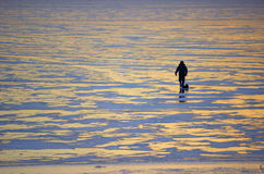 Winter landscape fisherman on the river Stock Photography
