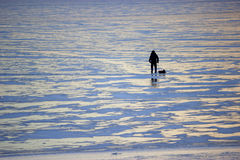 Winter landscape fisherman on the river Royalty Free Stock Photos
