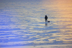 Winter landscape fisherman on the river royalty free stock image