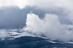 Winter landscape with fog in the mountains Stock Images
