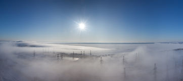 Winter landscape. fog over earth. Panorama Stock Photos