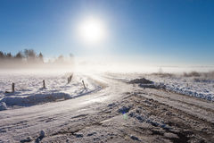 Winter landscape at fog  with road Royalty Free Stock Photos