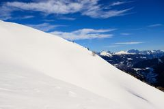 Snow, sky and clouds in the mountains Royalty Free Stock Photos