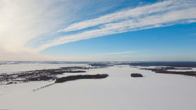 Winter landscape with forest, field. Winter landscape. The field covered with snow in a winter season. Aerial view: Winter landscape countryside, forest, field stock video