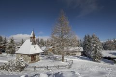Winter landscape, forest and little village in mountain royalty free stock photo