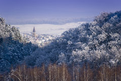Winter landscape forest transylvanian village. And church tower sunny day Royalty Free Stock Photos