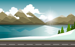 The winter landscape of forests, mountains, road and lake. Stock Images