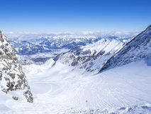 Winter landscape with free ride piste and view on snow covered slopes and blue sky, with Aerial view of Zell am See lake. From the top of Kitzsteinhorn mountain stock photo