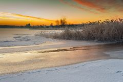 Winter landscape at frozen bay of Puck. Royalty Free Stock Image