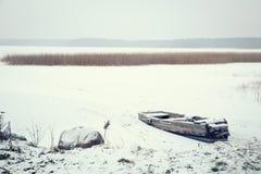 Winter Landscape. Frozen Boat on the Lake. Stock Photo