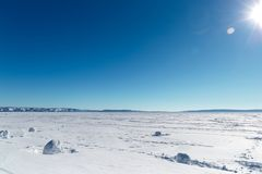 Winter landscape. Frozen lake on a clear winter day. Frozen Lake royalty free stock photos