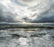 Winter Landscape frozen lake with ice floes and cloudy sky in Ic Royalty Free Stock Image