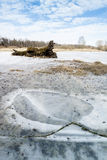 Winter Landscape with Frozen Lake. Log and Blue Sky stock photo