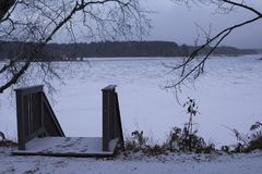 Winter landscape with frozen lake stock image