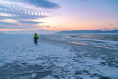 Winter landscape with frozen lake and sunset sky Stock Image